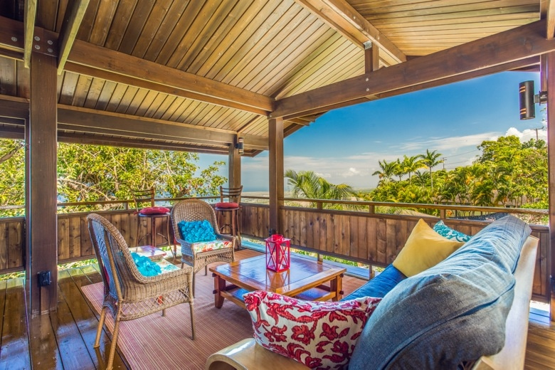 The cottage lanai seating area with large futon couch; view to the northwest.