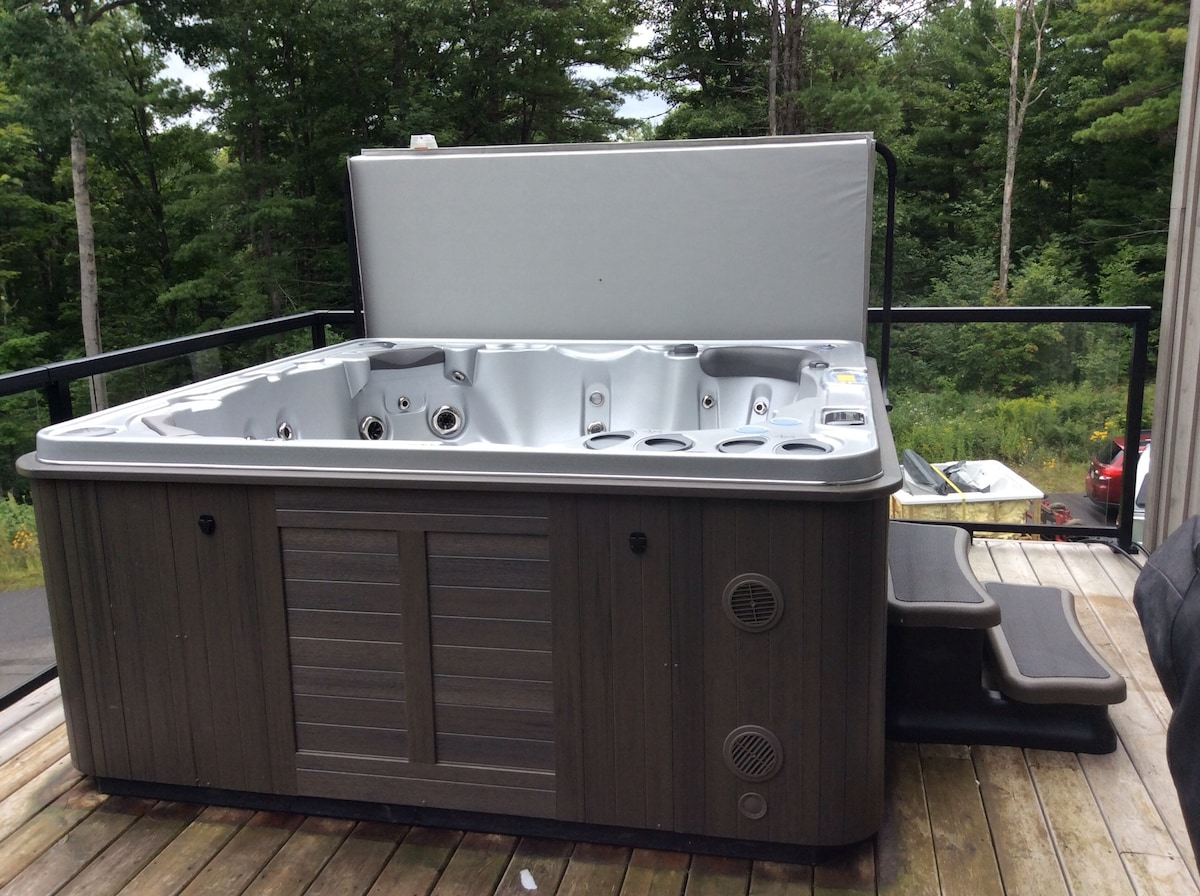 Brand new hot tub - installed August 2014!  Equipped with bluetooth, surround speakers and LED lights.  Available for use year round!