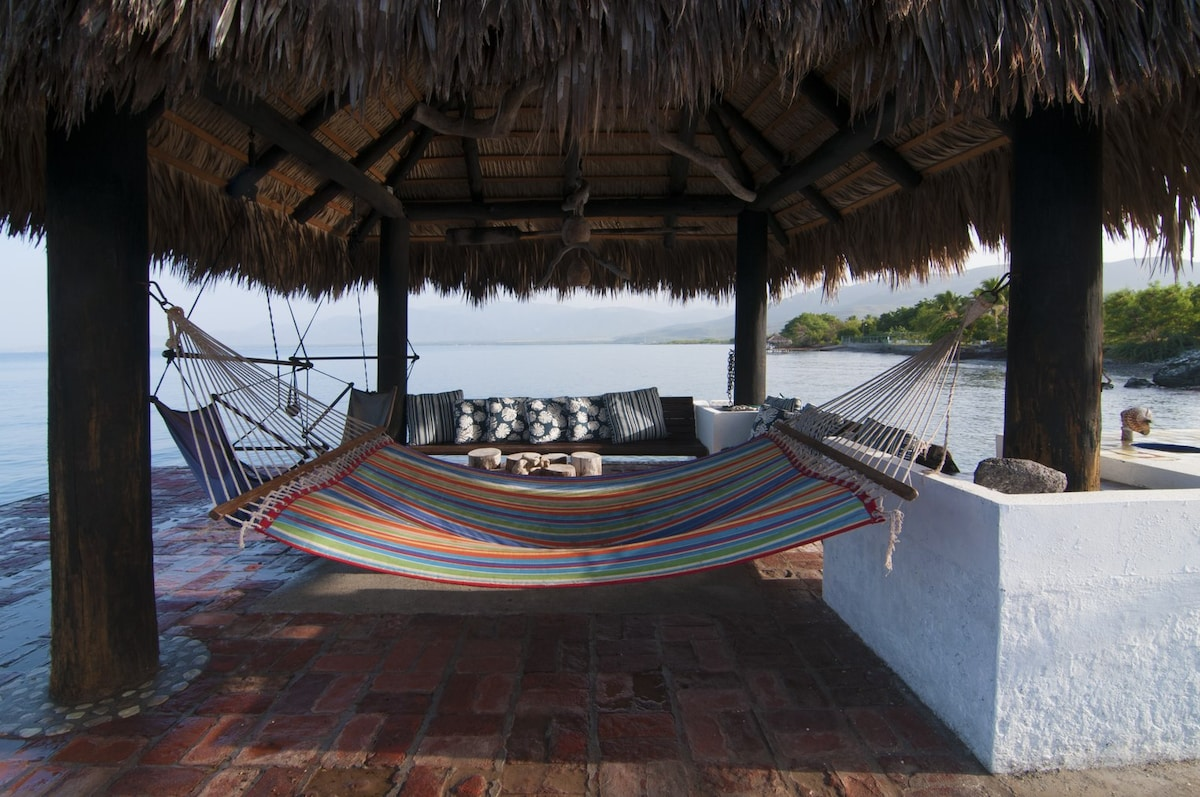 Interior of Palapa with hammock, air chairs and benches.