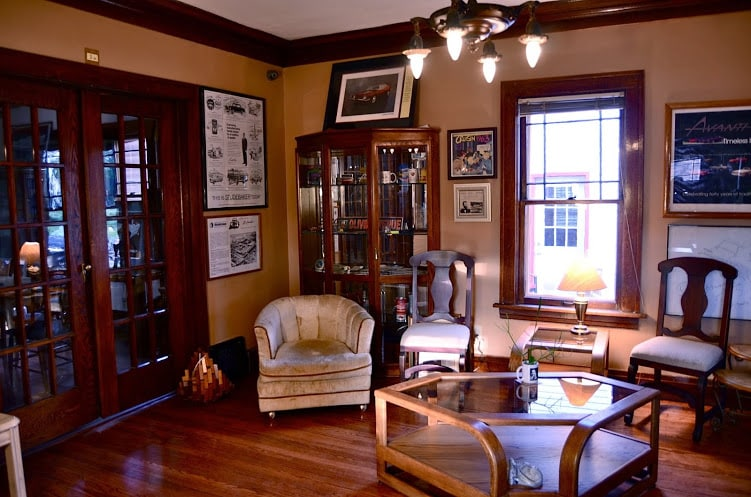 Meet with new friends in the living room or browse Avanti memorabilia. Appreciate the meticulously restored woodwork.