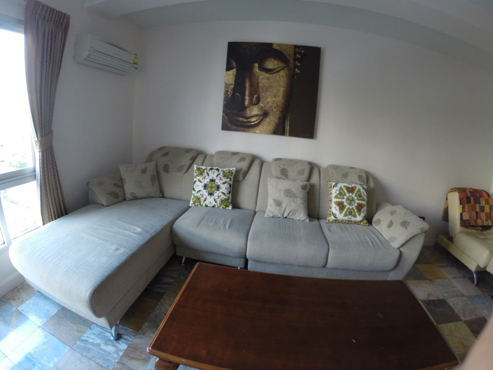 Living/TV room with a settee as extra bed.