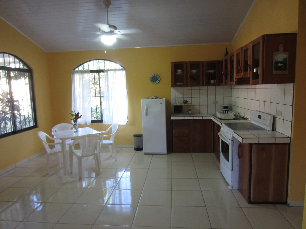 Kitchen flows into Dinette and Living Room