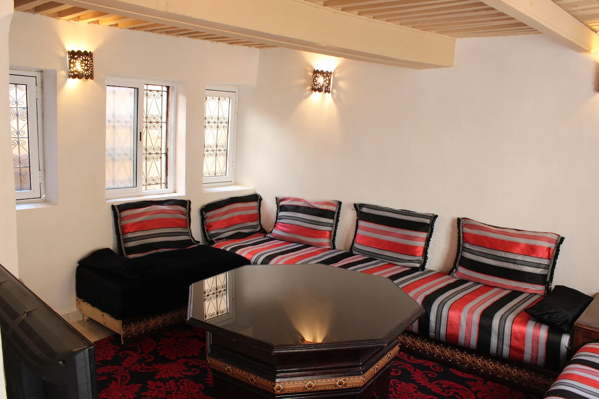 The salon - the lounge room of the house.  Plenty of seats or spare beds if you need them!