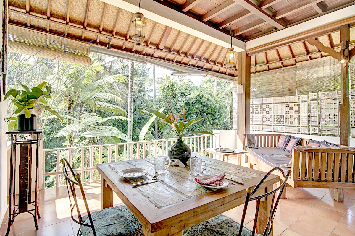 Dining Area: overlooking the Jungle.   Table made from recycled sailing boat wood. Ancient wrought iron chairs. Comfortable teak wood sofa
