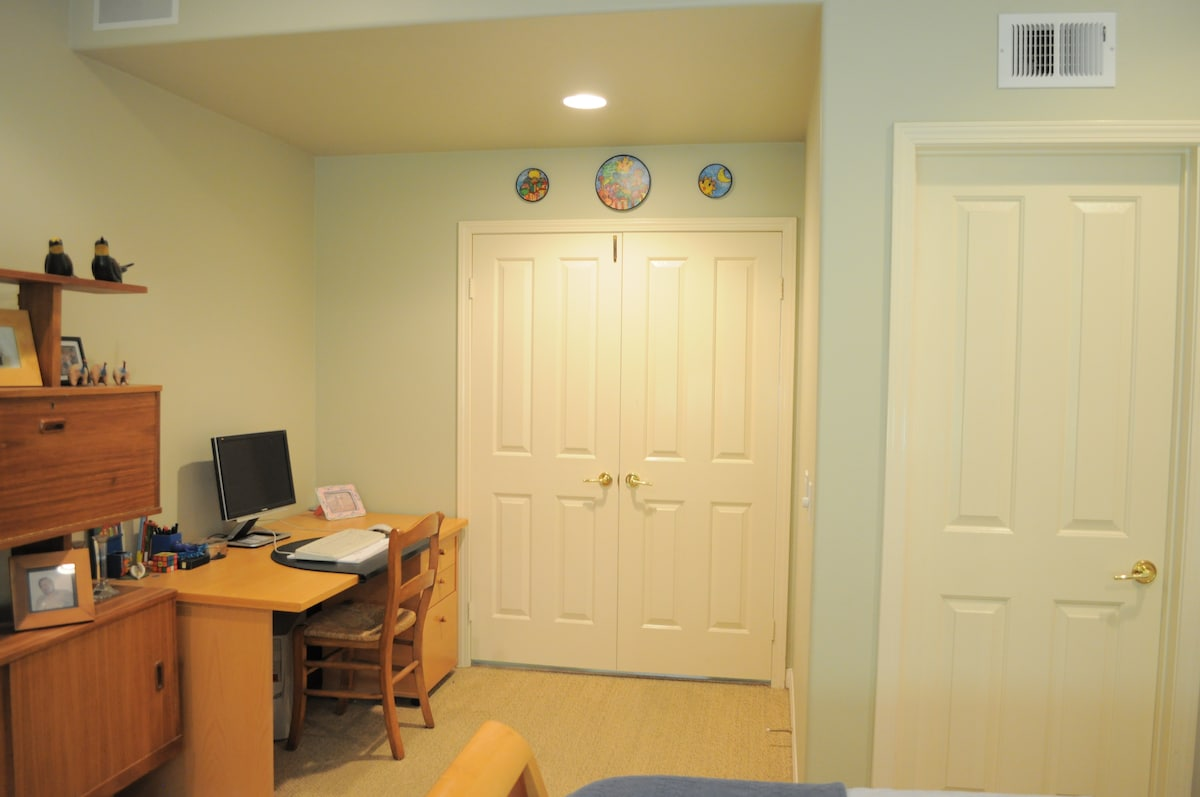 Guest bedroom: double door entry, study area   with enclosed private full bathroom (door on right)