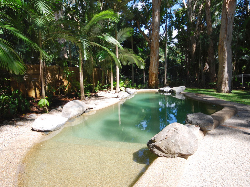 Relax in the private heated swimming pool