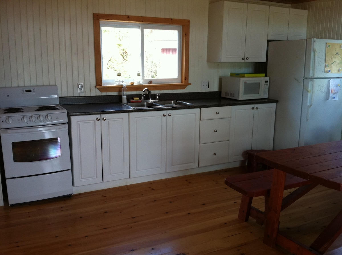Kitchen area, all new appliances and dishes.