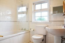 Bathroom to share with one other room - bath with hower over.