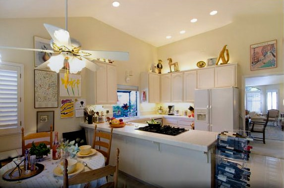 The full kitchen features a dishwasher and small appliances like a microwave, toaster, blender, and coffee maker.