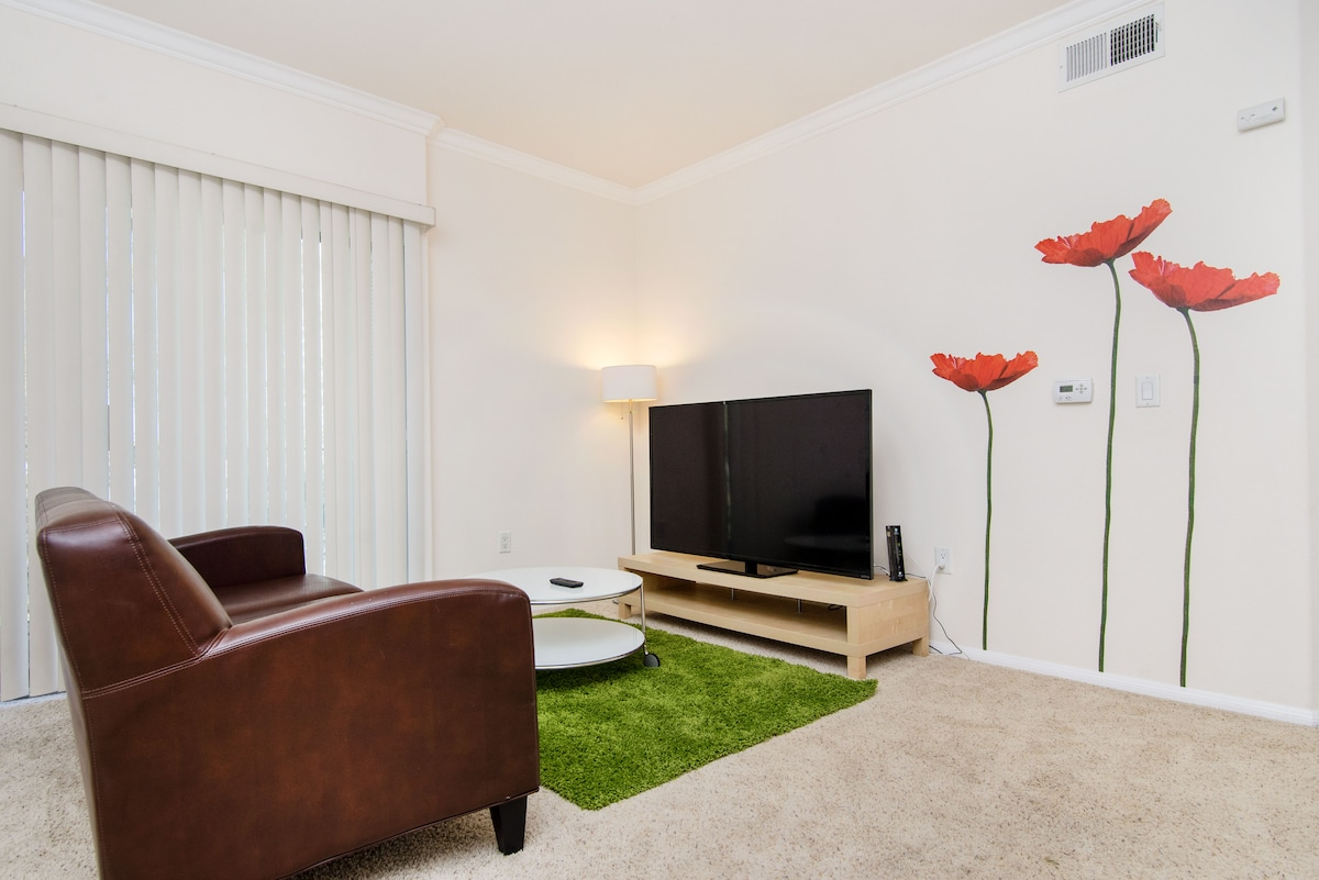 60 Inch LED Smart TV,Private Balcony, Dinning Table, Room #1 of 2 with private Balcony, Restrooms, Walk in Closets.