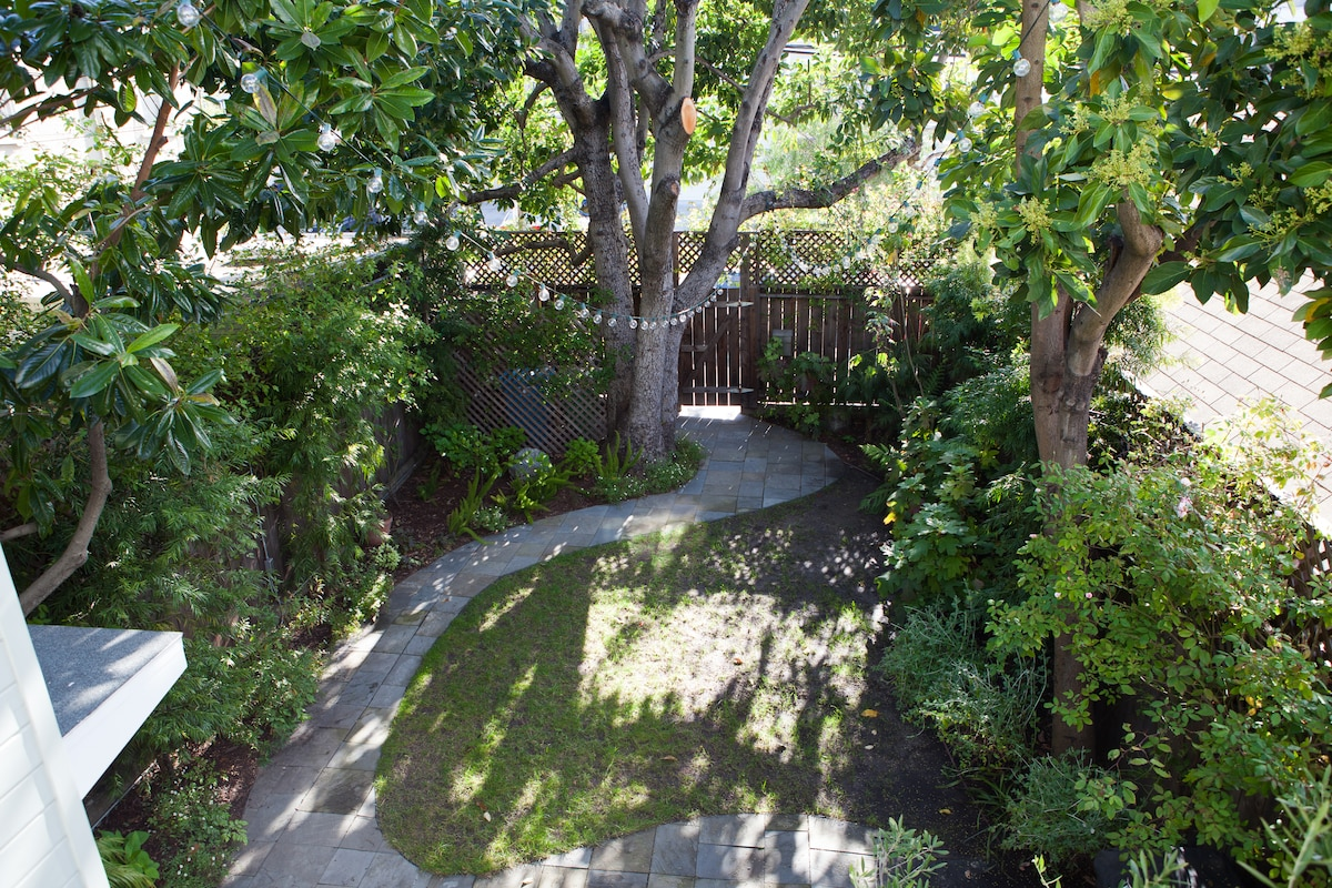 View of the front yard from balcony outside Master Bedroom.