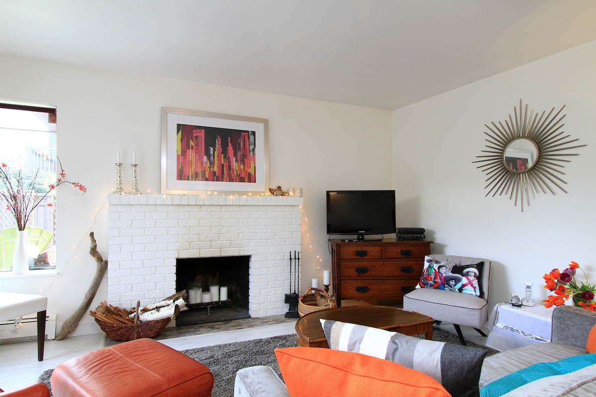 Living area with wood-burning fireplace.