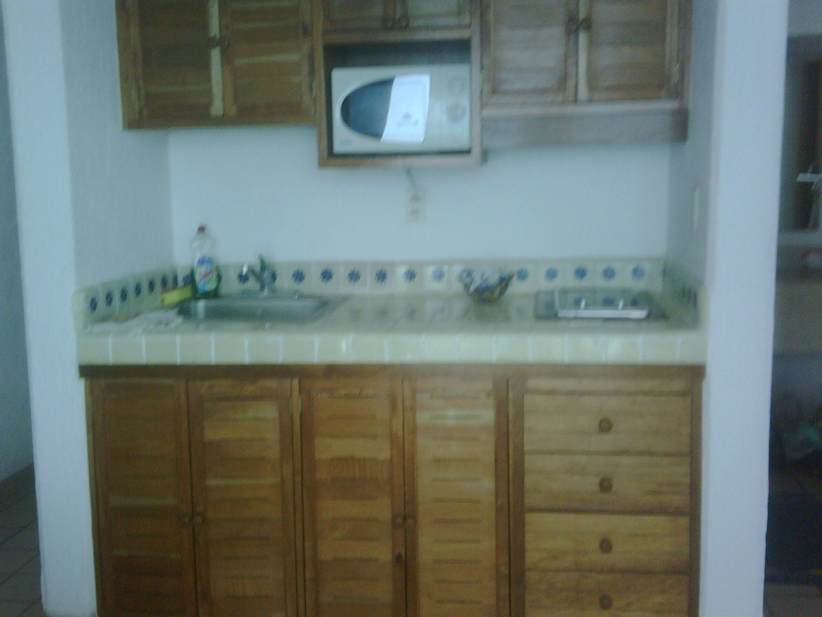 Your very functional kitchen with 2 ring stove top burner & microwave oven.  Everything you need!
