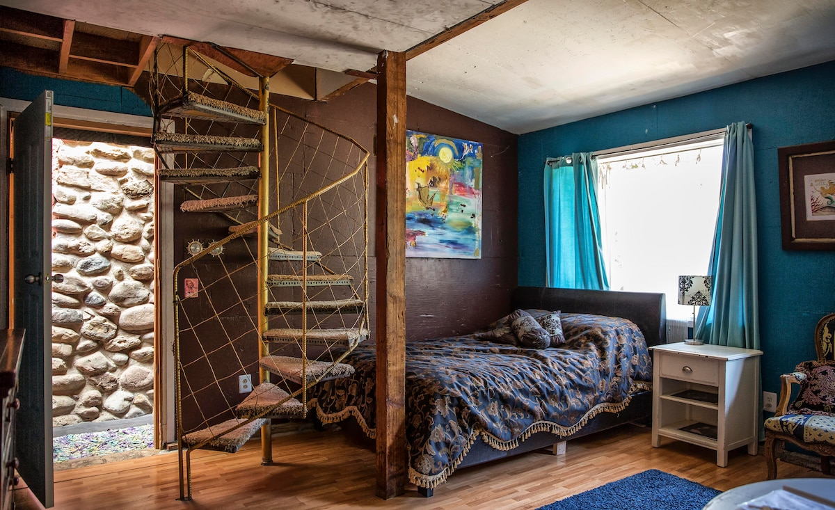 Super comfy queen bed and golden spiral staircase