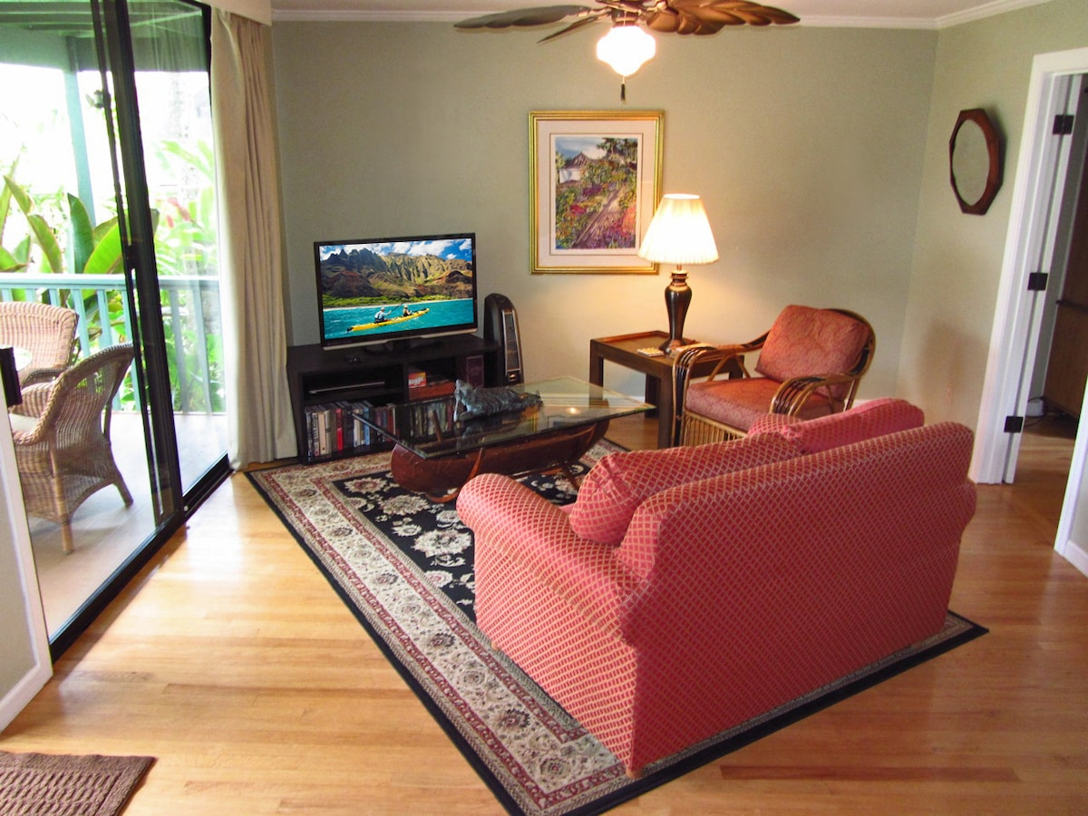 Another view of the living room with HDTV and slider to your covered lanai