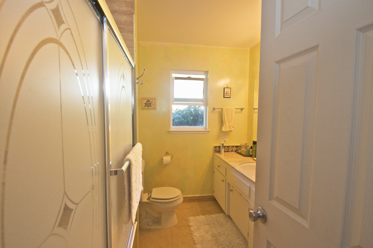 Our bathroom is modern and offers privacy to our guests.