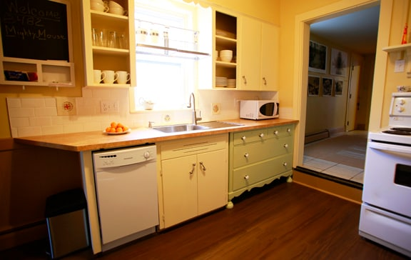 A dishwasher and attached drainboard sink make it easy to get out of the kitchen.