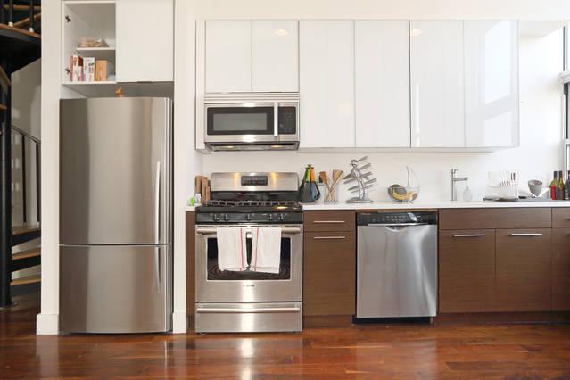Fully stocked kitchen with fridge, oven and dishwasher
