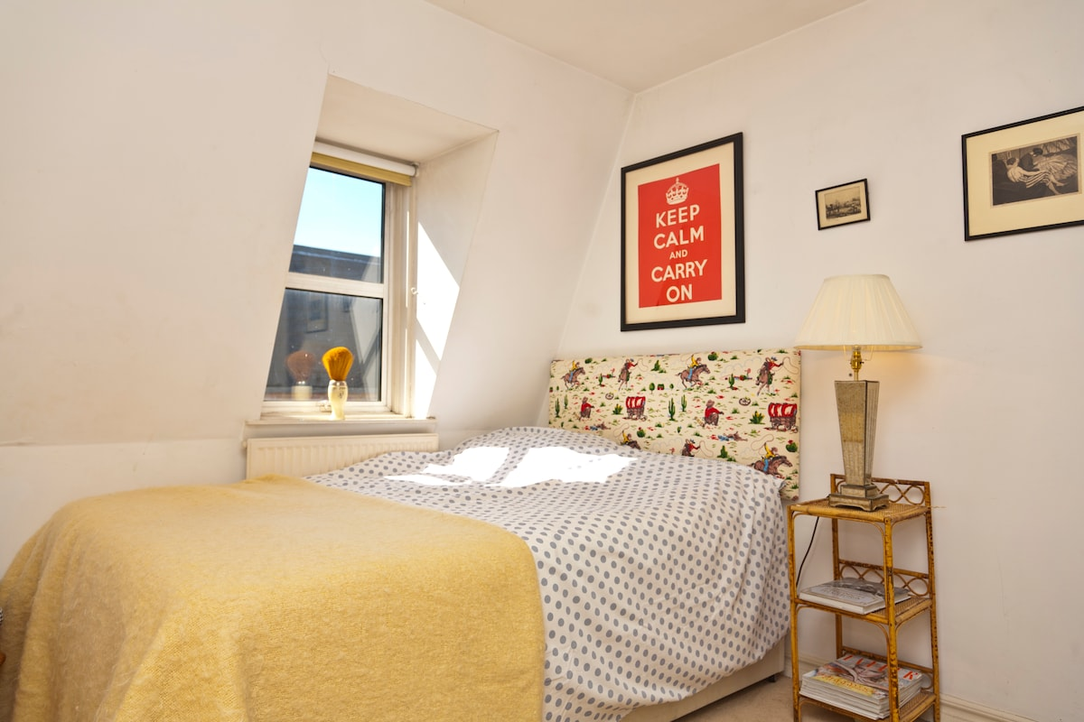 Your bedroom - very cute, light and breezy with lots of sunlight and lovely views down the mews