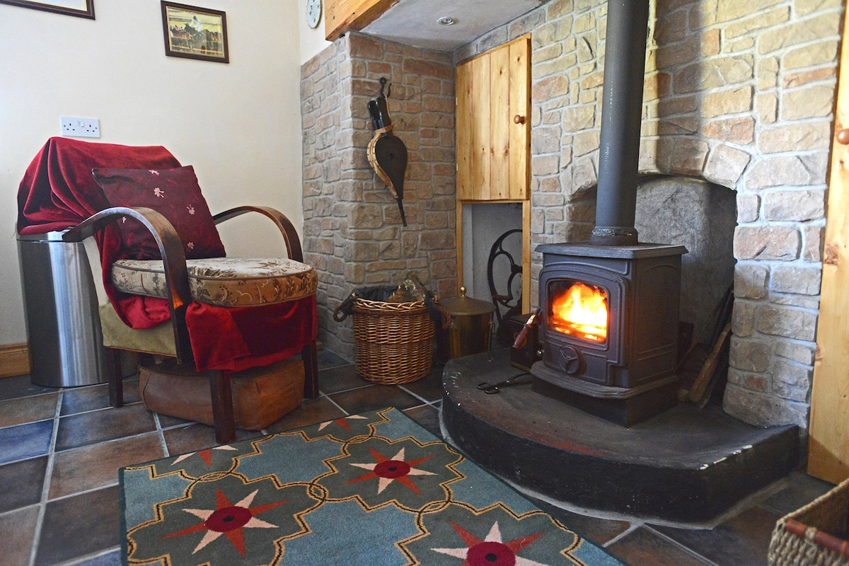 The warm fire is waiting for you! Logs are supplied for your use.