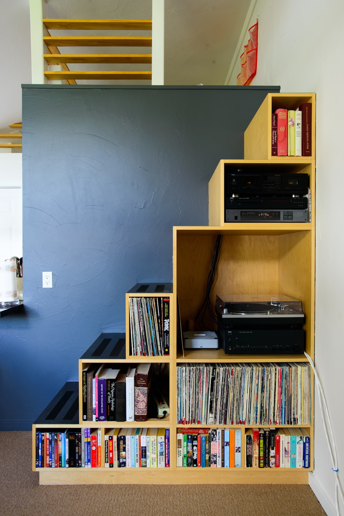 Steps up to the loft with records, turntable, & a great stereo.