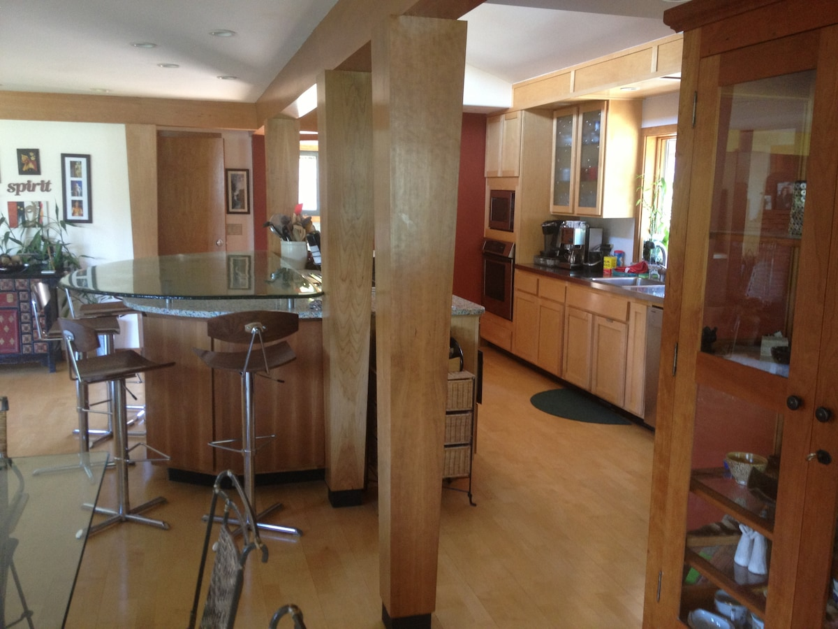 View of the kitchen from the second living room.  Glass bar seats 6 people.