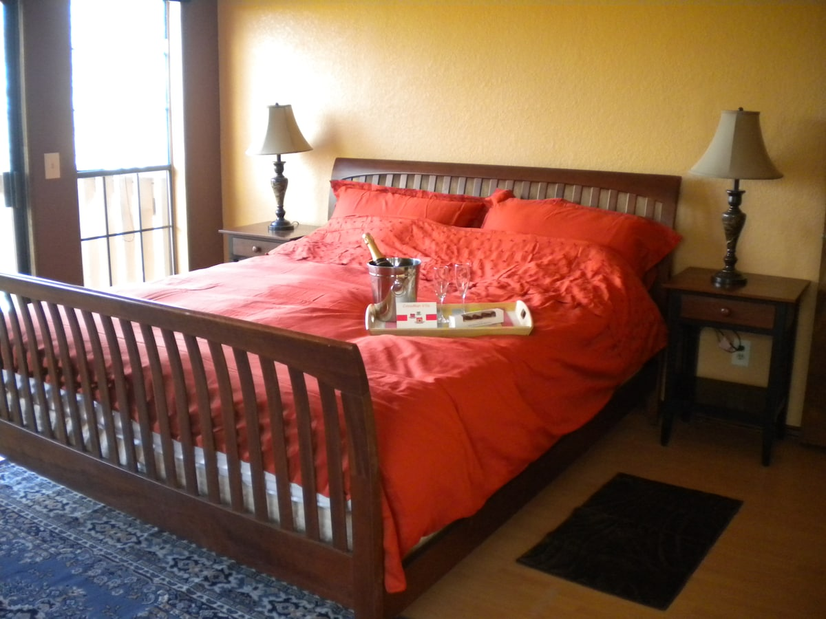 Well-dressed king size bed with memory foam mattress and European duvet