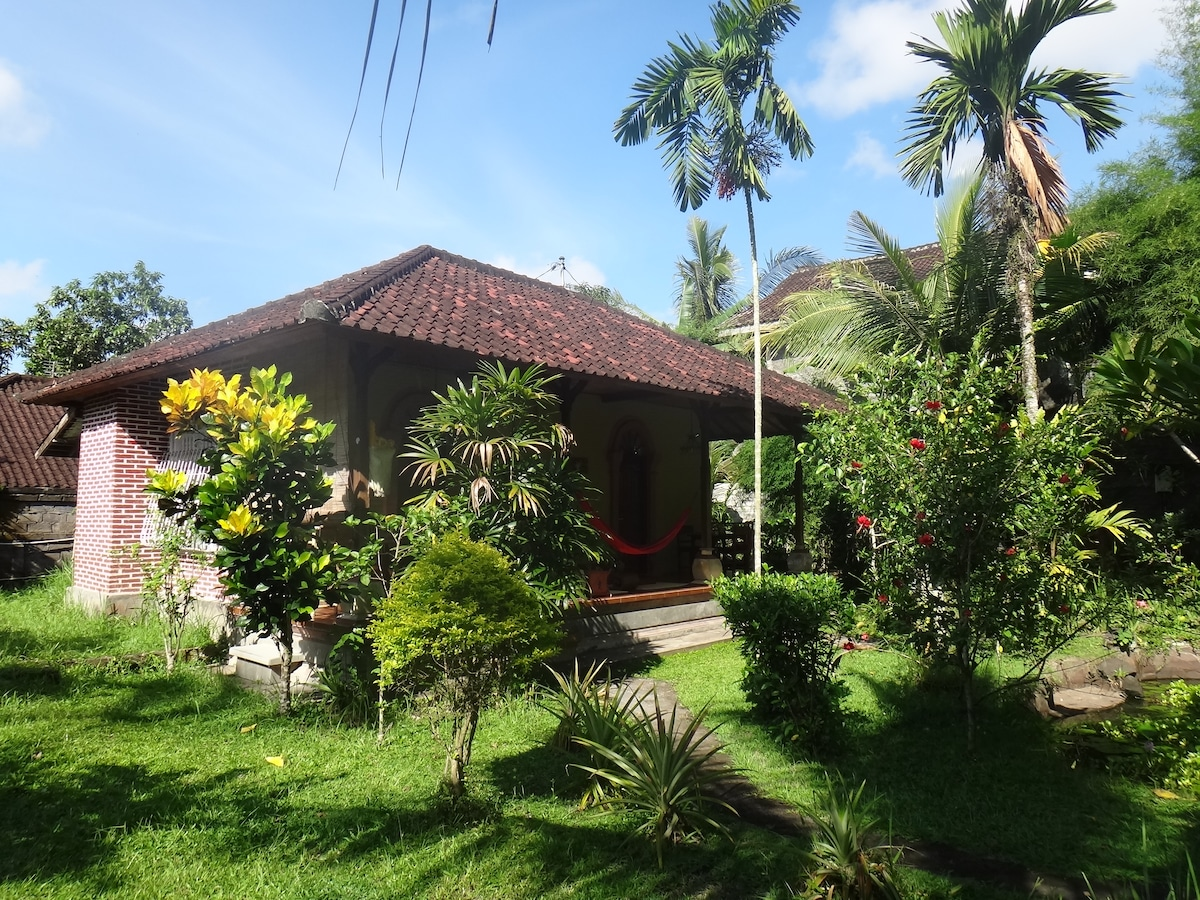 the bungalow standing in a tropical garden