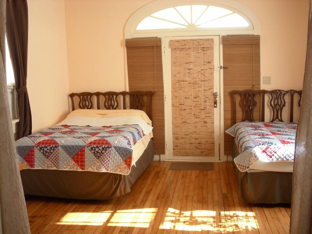 Second bedroom with 2 full size beds, air conditioner, TV