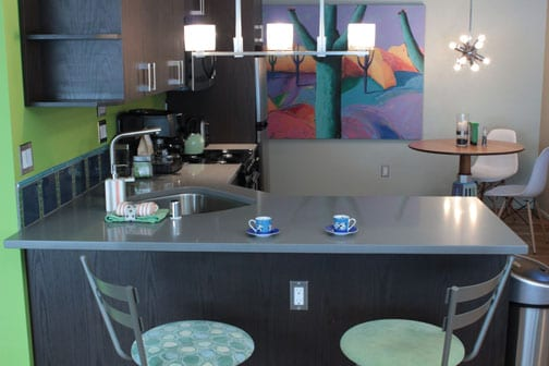 Silestone counters with lots of cabinets and bar seating