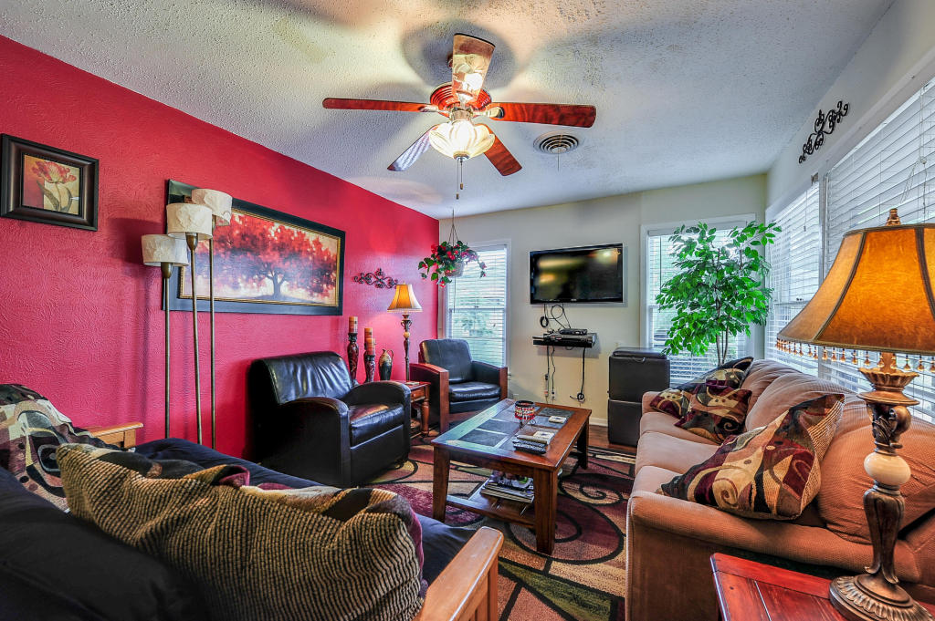 """The living room is bright with lots of windows.  A queen sized futon and roll away couch make for a comfortable night sleep.  There is a 3"""" thick foam rubber mattress to help with comfort on the couch roll away."""