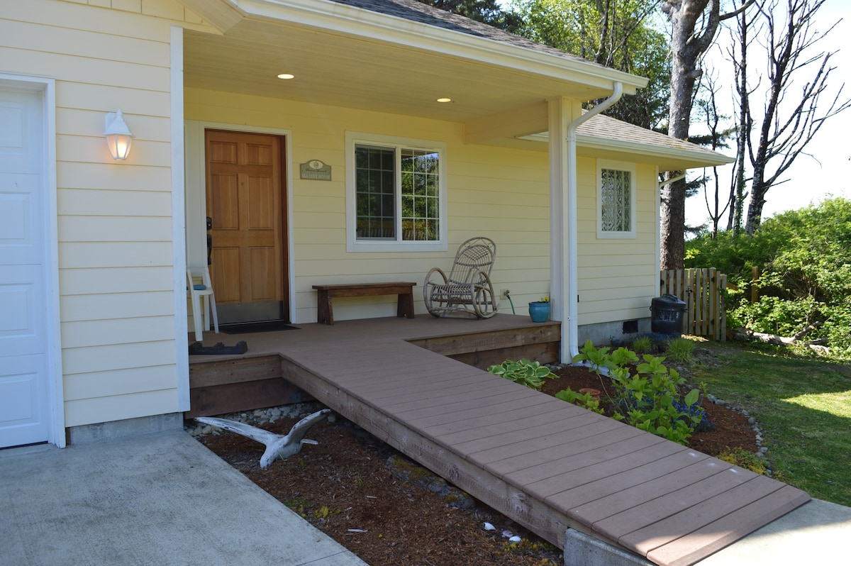 Covered entry to Seamist house features ramp entry covered porch and a single car garage for your use.