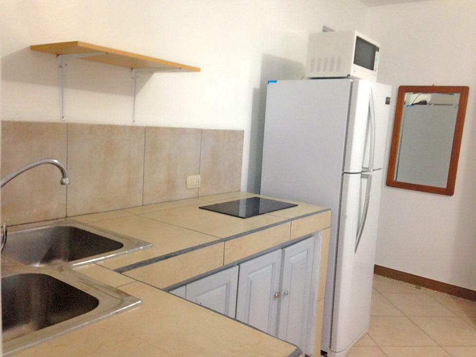 Full size refrigerator, ceramic digital electric stove with well sized kitchen space.