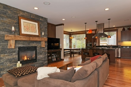 great room + kitchen. large windows (not seen in this view) look out onto 100 year old redwood trees and wooded area.
