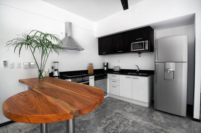 Fully Stocked, Modern Kitchen, Granite Countertop , Hardwood Breakfast Bar - Modern Tropical Luxury at its Best!