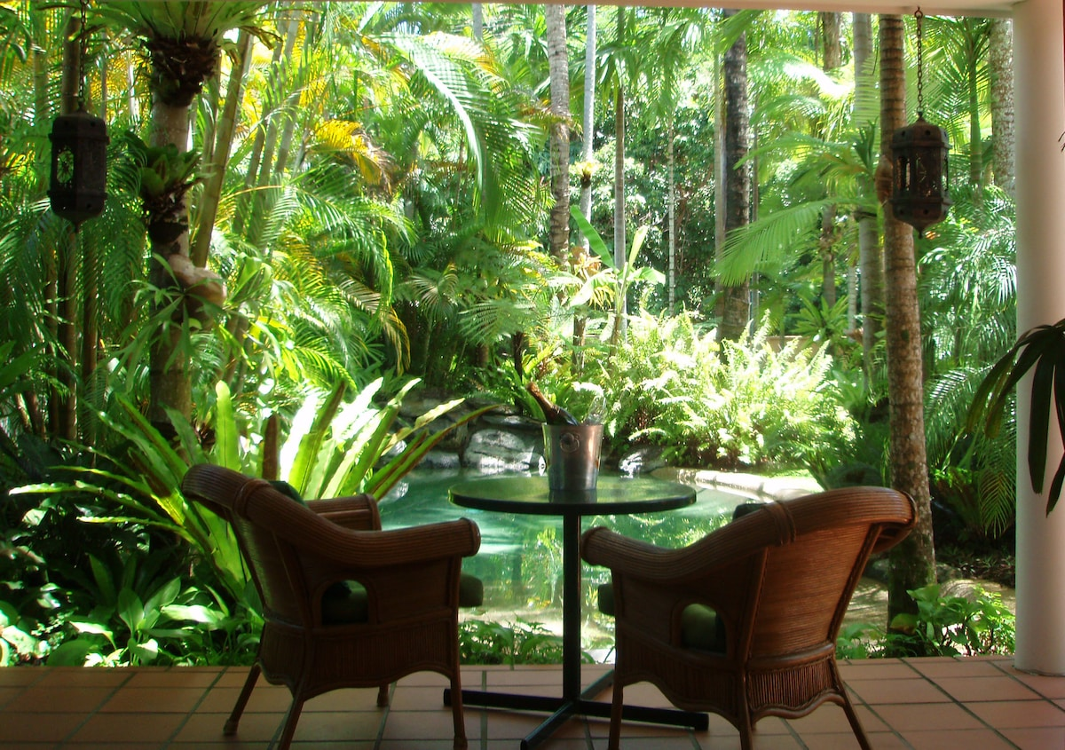 View from the verandah to the pool & tropical gardens -  beach 50 metres.
