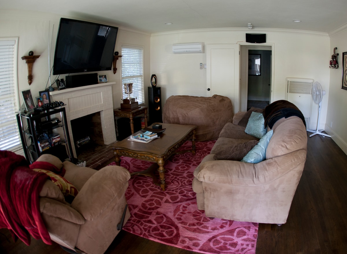 "Living room equipped with 60"" Plasma, Hi-Def surround sound with iPod, iTunes & Air-Play syncing capabilities."