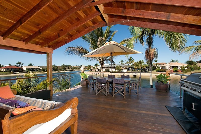 Timber deck, al fresco dining,bbq, balinese day bed overlooking sandy beach and waterway