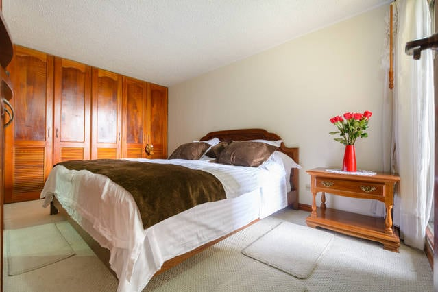 king size bed in the master bedroom with luxury mattress really comfortable. Too has full length closets waiting for your clothes.