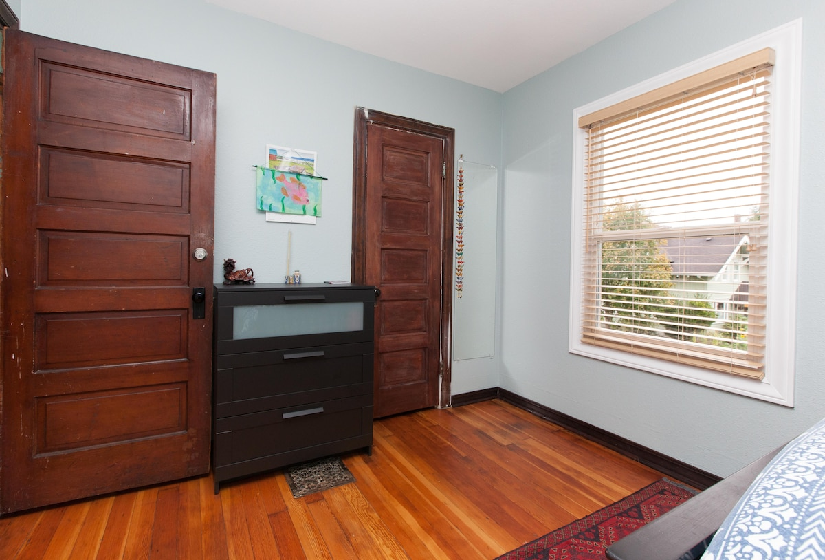 The blue hosts a large closet and dresser