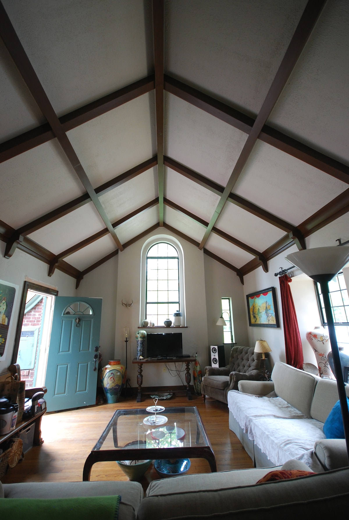 living room with cathedral ceiling.