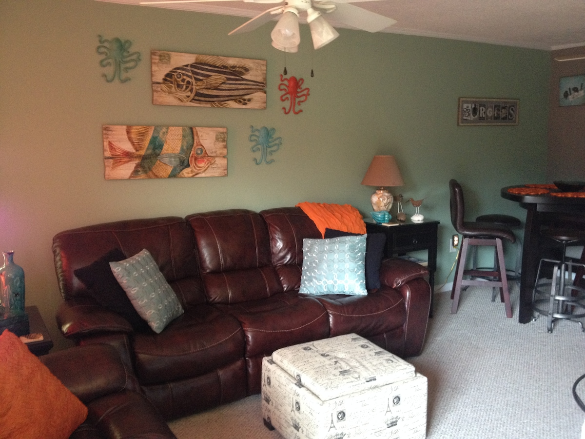 "Living area includes reclining furniture, 36"" flatscreen TV, internet enabled DVD, free wireless internet service. Cable service includes HBO."