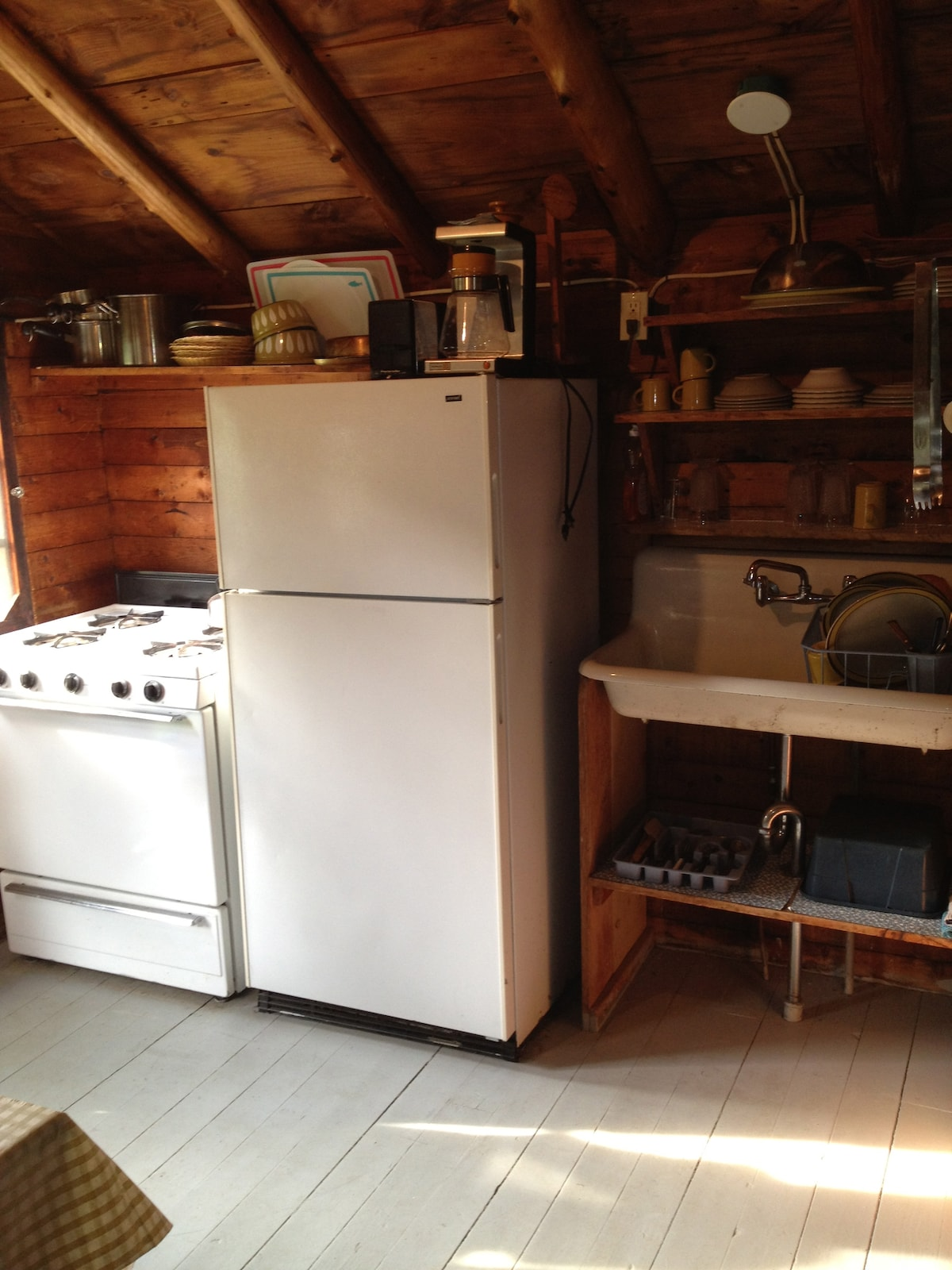 full, tidy, well organized kitchen.  Range, oven, fridge, sink. toaster, coffee maker, fully supplied with dishes, pots, etc.