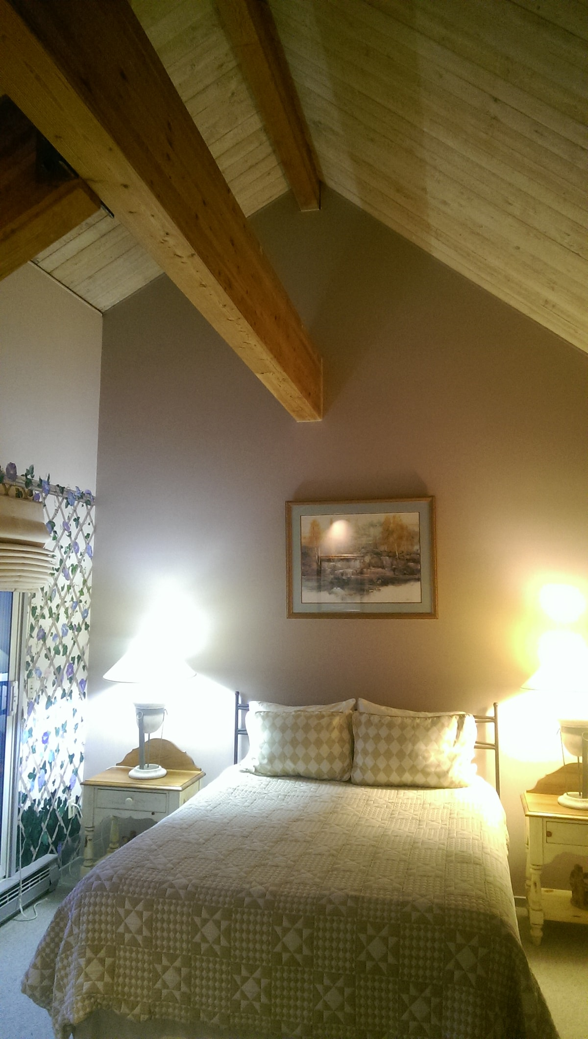 Click through to see fuller view of exposed beams and cathedral ceiling in master BR