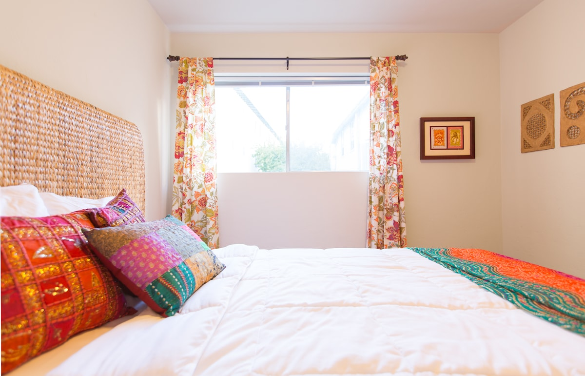 Colorful guest bedroom with queen bed