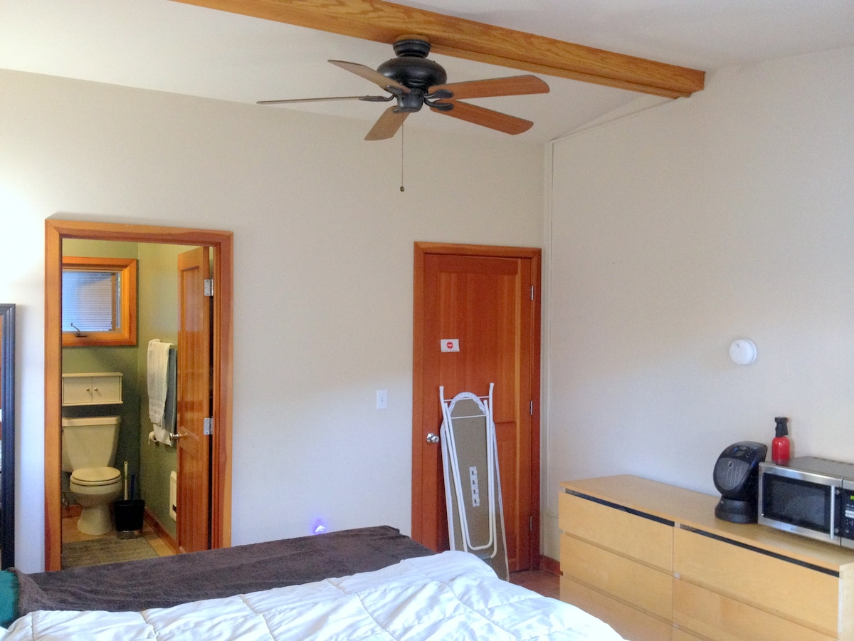 Tall ceiling with fan