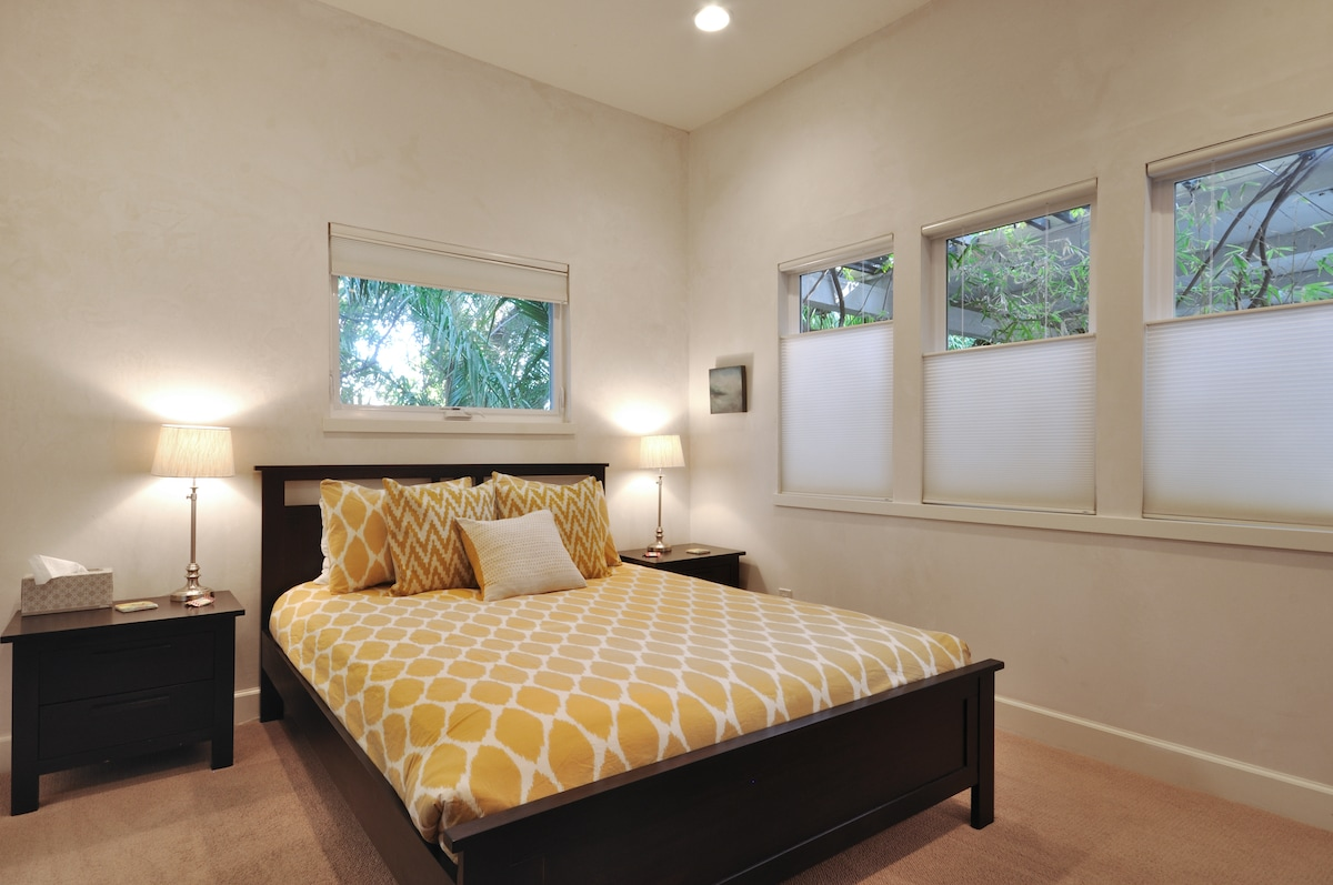 Queen-size bed. Privacy shades can be open and closed from the top and bottom.