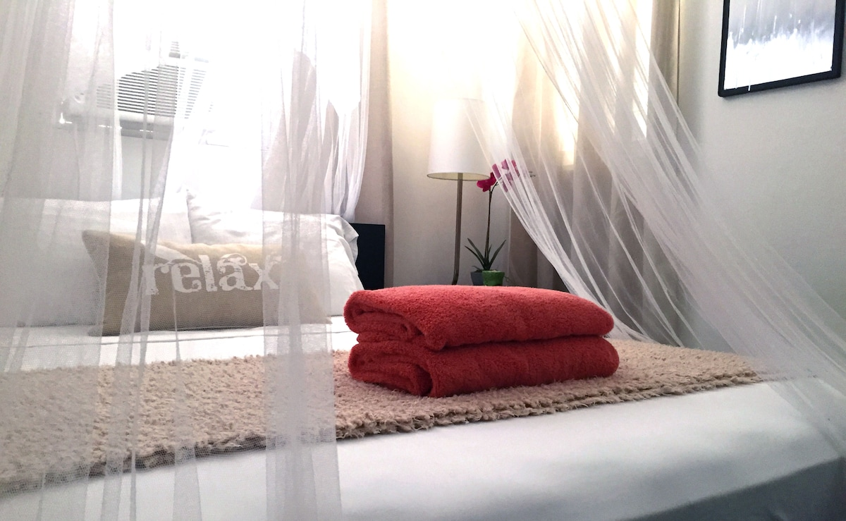Air conditioned bedroom with a super comfy, firm, queen mattress.