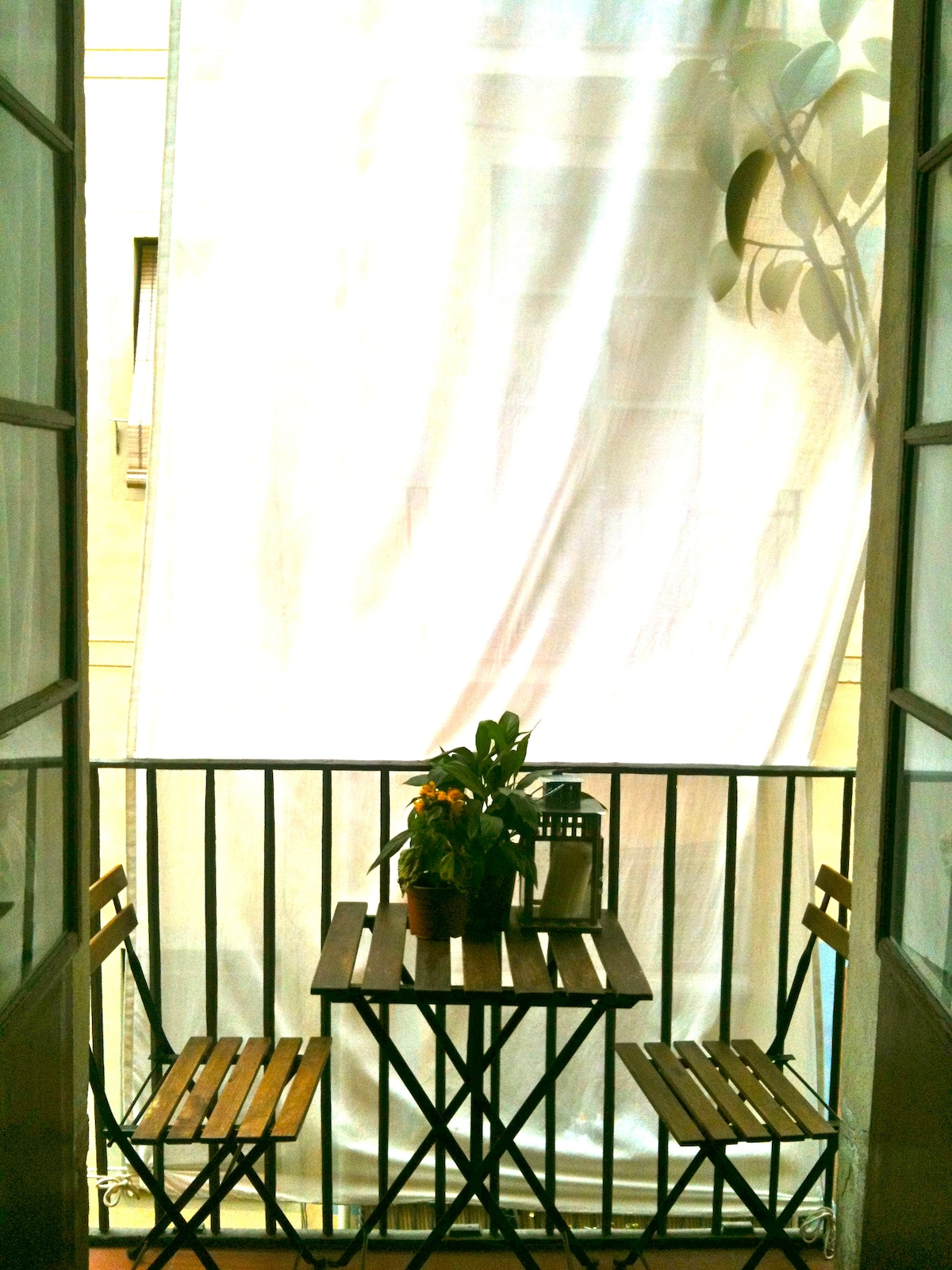 Balcony with small breakfast table and chairs  :)