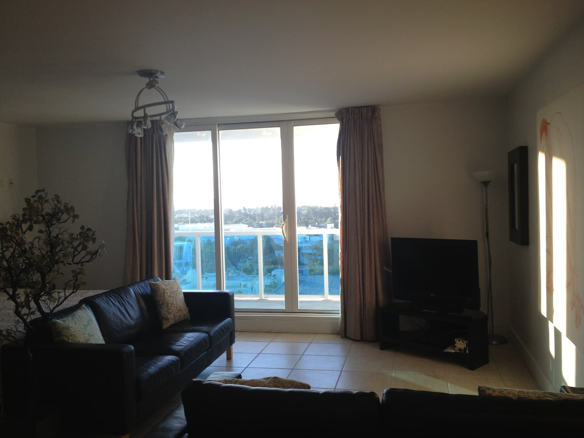 Living Room-Black leather sofa-which opens up to a bed, HD TV with cable and internet